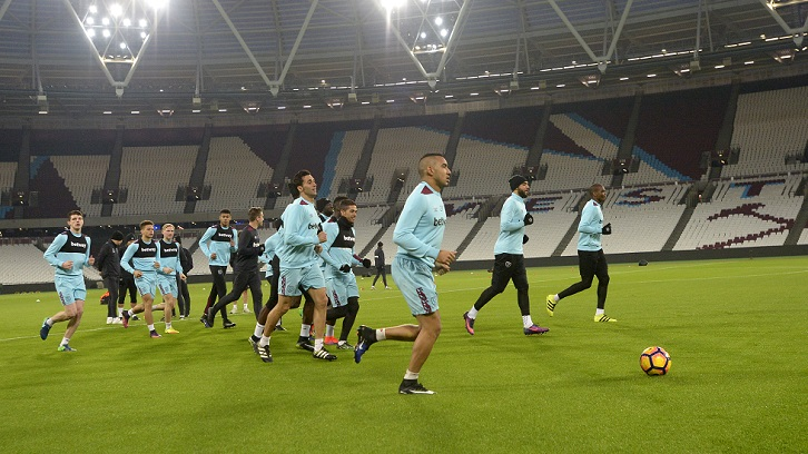 STRATFORD, ENGLAND - DECEMBER 02:  General view of West Ham United players warming up during training at London Stadium on December 2, 2016 in Romford, England.  (Photo by Arfa Griffiths/West Ham United via Getty Images)