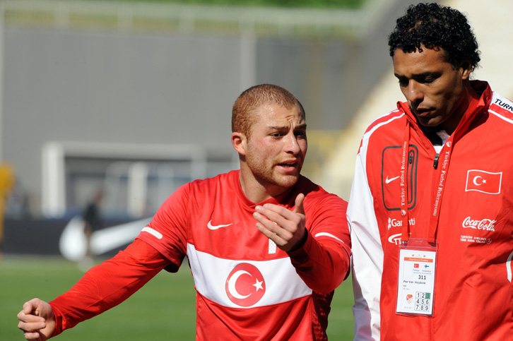 Turkey's Gokhan Tore (L) talks with Turkey's assistant coach Pier Van Hoijdonk during their A2 international friendly football match against Finland at Recep Tayyip Erdogan Stadium in Istanbul on March 25, 2011. AFP PHOTO/BULENT KILIC (Photo credit should read BULENT KILIC/AFP/Getty Images)