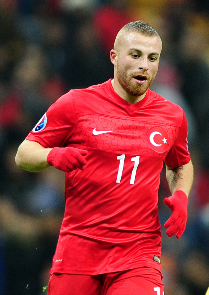 Turkey`s Gokhan Tore in action during the UEFA Euro 2016 qualifying football match Turkey vs Kazakhstan on November 16, 2014 at TT Arena stadium in Istanbul. AFP PHOTO/OZAN KOSE (Photo credit should read OZAN KOSE/AFP/Getty Images)